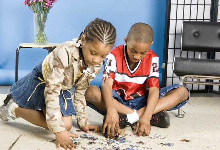 Two children playing with a puzzle