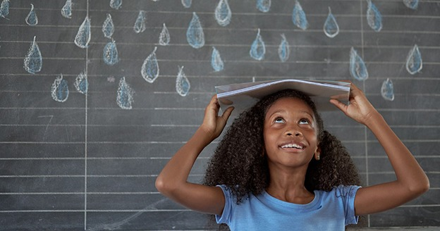 Girl hiding from rain under a book